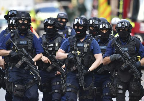 Armed police on St Thomas Street, London, on June 4, 2017, near the scene of Saturday night's terrorist incident on London Bridge and at Borough Market.