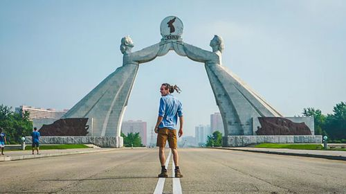 Louis Cole in front of the Arch of Reunification in North Korea. (Louis Cole/YouTube)