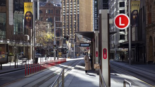 Commuters in the nearly empty Sydney CBD.