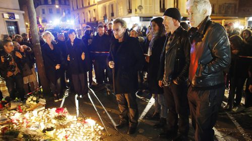 The band paid their respects the day after the Paris attacks, visiting the Bataclan Theatre where 89 people lost their lives. (AAP)