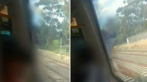 A shocked commuter filmed as a man clung to the outside of a train after a door failed to open.
