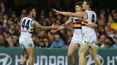 Adelaide hang on to end Lions' run in AFL