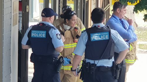 AFP and MFB members outside the Swiss Consulate in Ashwood.