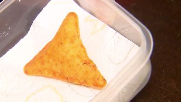 """A Gold Coast teenager is looking to turn a three-dollar bag of Dorito's into an over $20,000 payday after finding a rare """"puffy"""" version of the popular chip."""
