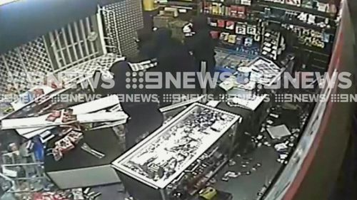 The thieves were trapped inside the store after the employee triggered an alarm to lock the doors. (9NEWS)