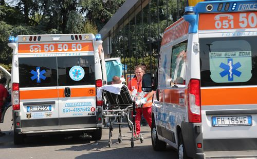Paramedics treat the injured. Picture: AAP