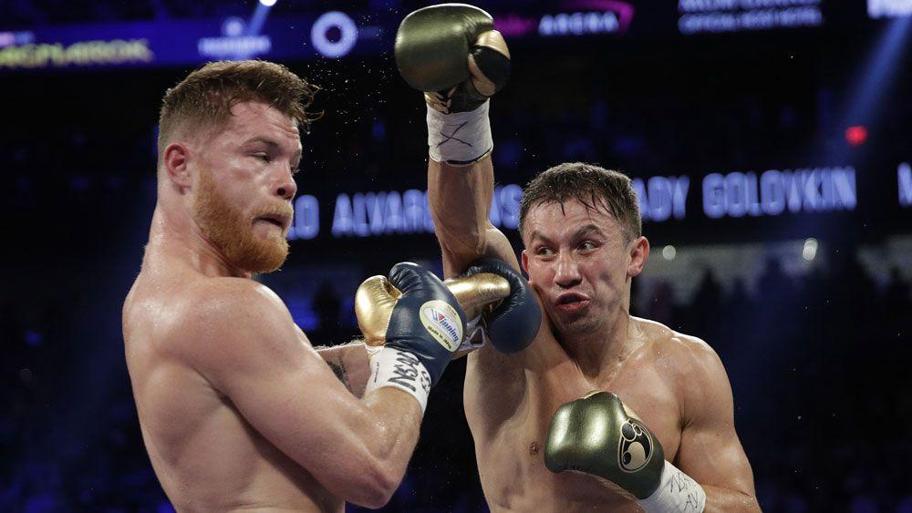 Canelo Alvarez reels away from a Gennady Golovkin punch. (AAP)
