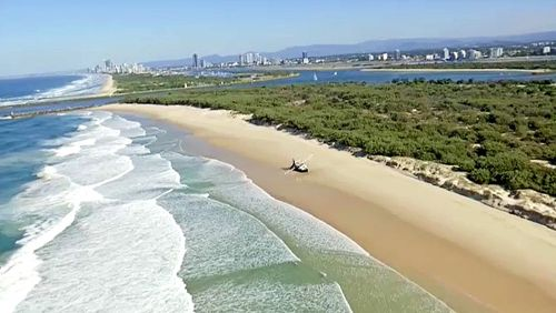 The trawler was attempting to travel through the Gold Coast seaway before it was pummelled by the waves.