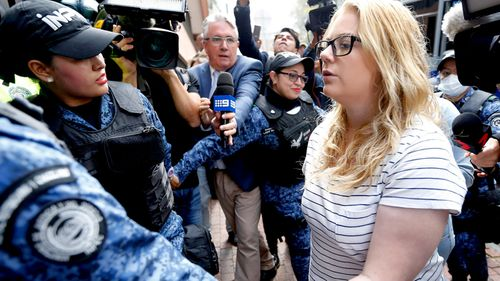 Cassie Sainsbury is escorted into court to await her hearing. (AAP)