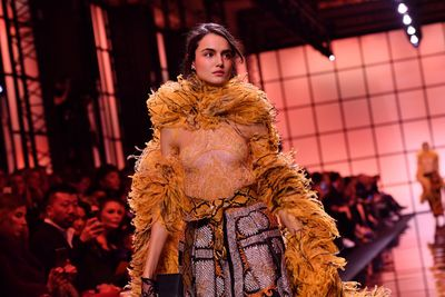 Giorgio Armani Prive Paris Haute Couture Spring Summer 2017. Feathers, fringing and bold orange shades.