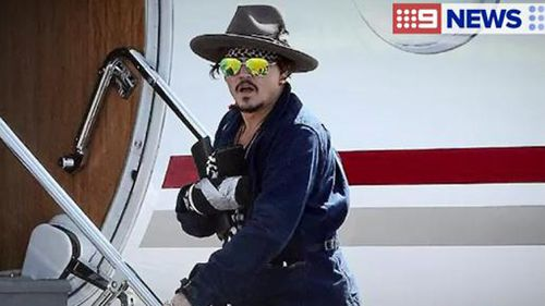 Johnny Depp flies back to LA after injuring hand