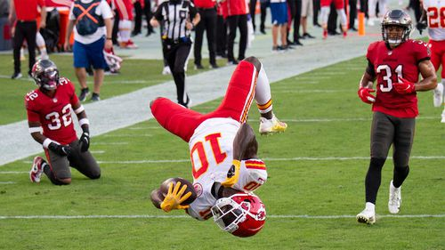 Kansas City Chiefs wide receiver Tyreek Hill  does a back flip into the end zone to score a touchdown against the Tampa Bay Buccaneers during a game in November.