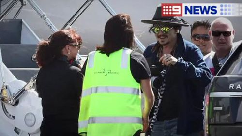 Depp chats to airport staff. (INF Photo)
