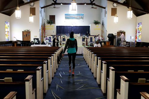 US churches hold Palm Sunday services despite state bans on gatherings