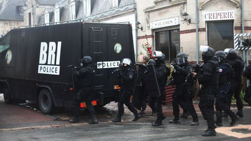Heavily-armed French police patrol in Longpont, north of Paris during the hunt for the Charlie Hedbo gunmen, (AAP)