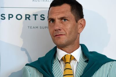 Kookaburra Jamie Dwyer looked dapper with tie and the green jumper drapped over his shoulders.