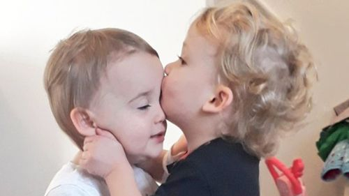 A British woman has appeared in court charged over the murder of her toddler twins following a car crash.