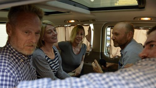 From left, sound recordist David Ballment, reporter Tara Brown, Sally Faulkner, producer Stephen Rice and cameraman Ben Williamson get into a van. (AAP)
