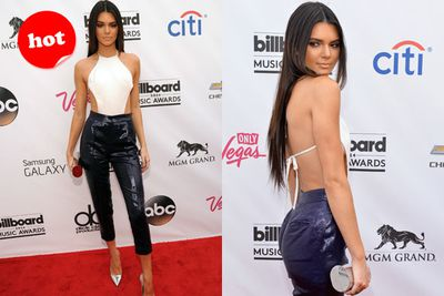 She's nailed that Kardashian-Jenner pose! Kendall scorches in sexy cut-outs on the red carpet.