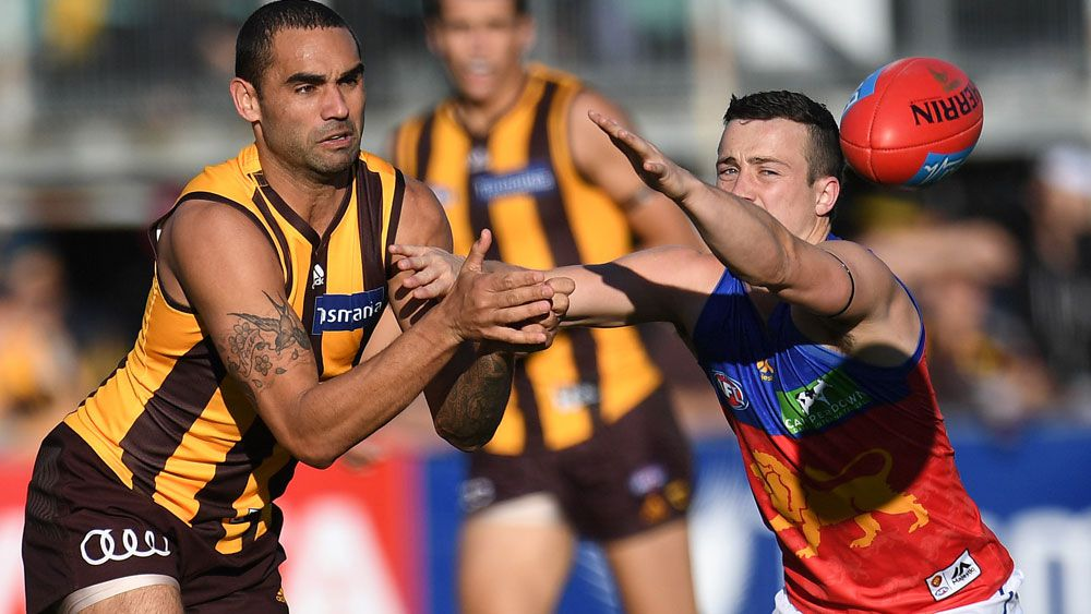Battered Hawks cruise past Lions in AFL