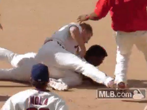 What made this baseballer tackle and punch a teammate?