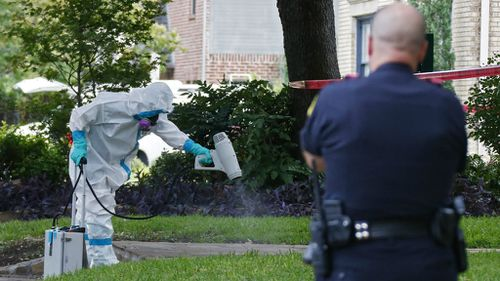A hazmat crew cleans outside Ms Pham's apartment. (AAP)