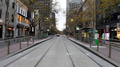 A near deserted street in the Melbourne central business district.