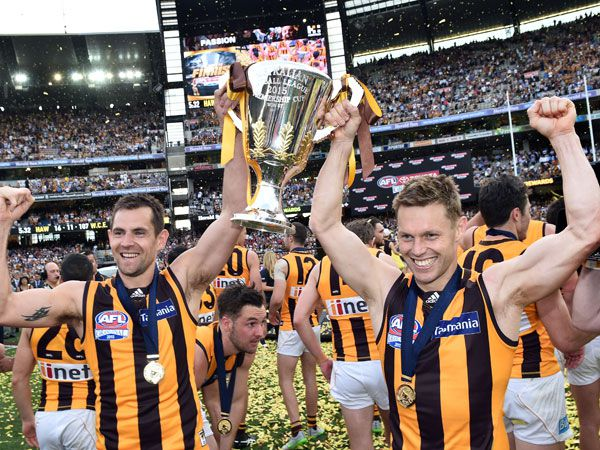 The Hawks celebrate last season's grand final triumph. (AAP)
