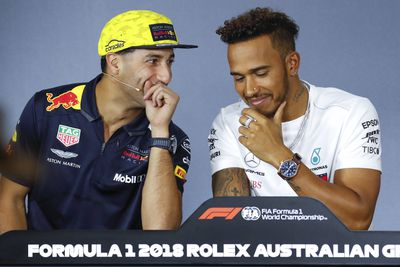 Daniel Ricciardo and Lewis Hamilton share a laugh at a press conference for the Grand Prix on Thursday night. (AAP)