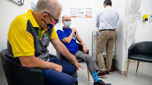 Scott Morrison and Dr Paul Kelly getting their second Pfizer vaccine at a GP clinic in Castle Hill, Sydney.