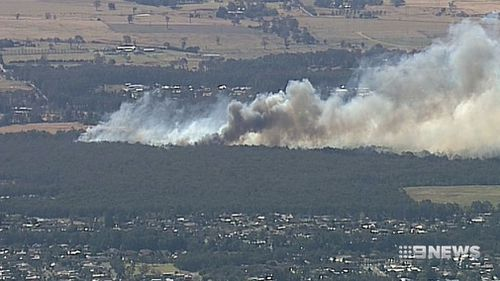 Bush fires fanned by strong, hot winds quickly spread.
