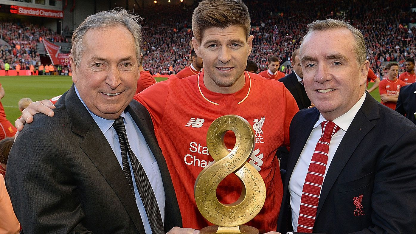 Steven Gerrard of Liverpool receives an award from Gerard Houllier and Ian Ayre Chief Executive of Liverpool FC during the Barclays Premier League match between Liverpool and Crystal Palace at Anfield on May 16, 2015 in Liverpool