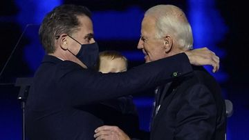 President-elect Joe Biden, right, embraces his son Hunter Biden, left, in Wilmington.