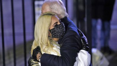 Democratic presidential candidate former Vice President Joe Biden hugs Lady Gaga during a drive-in rally at Heinz Field, Monday, Nov. 2, 2020, in Pittsburgh