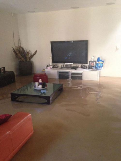 A flooded living room in Dulwich Hill. (Twitter @KateCreedon9)