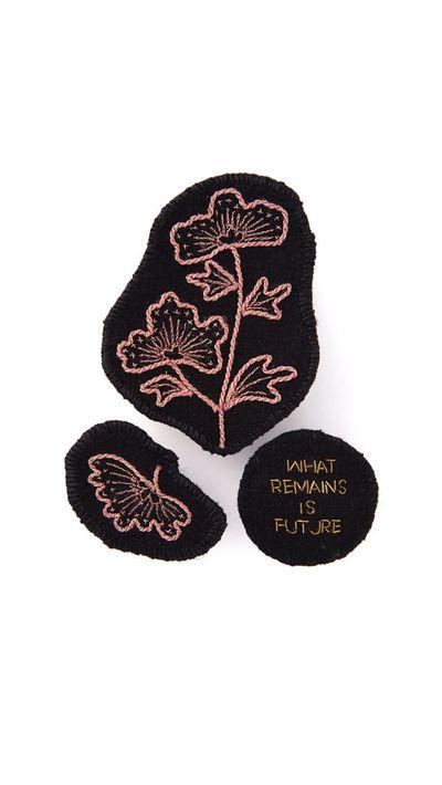 "<a href=""http://www.farfetch.com/au/shopping/women/ann-demeulemeester-embroidered-brooch-item-10889210.aspx?storeid=9462&amp;ffref=lp_9_1_"" target=""_blank"">Embroidered Brooch, $251.27, Ann Demeulemeester</a>"