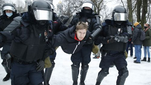 Police detain a man during a protest against the jailing of opposition leader Alexei Navalny in People gather in St.Petersburg, Russia, Saturday, Jan. 23, 2021.