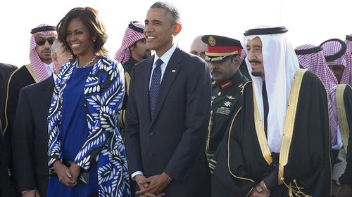 Donald Trump called out Michelle Obama for not wearing a headscarf during a 2015 visit to Saudi Arabia. (AAP)