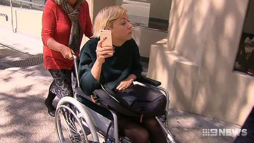 Mr Fry said Gray turned up to court in a wheelchair a day after she appeared perfectly fine as she dropped her son off.