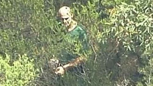 Aerial footage shows Vinzent Tarantino leading detectives through NSW bushland in 2016. (9NEWS)
