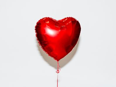 Red heart shaped helium balloon