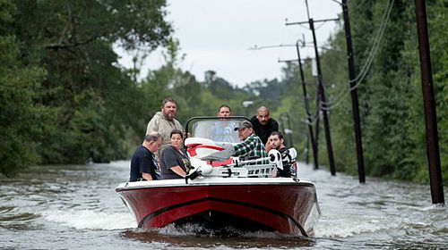 Boats evacuate residents from the floods around Beaumont in Texas. (Photo: AP).