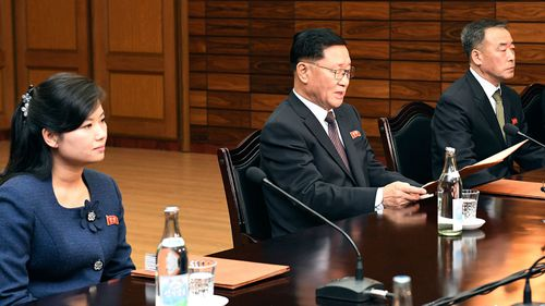 Head of North Korean delegation Kwon Hyok Bong, center, and Hyon Song Wol, the head of the Moranbong Band, left.