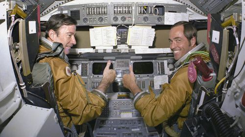 In this 1980 photo made available by NASA, astronauts for the first space shuttle mission, Commander John Young and Pilot Robert Crippen, take a break from their intensive training schedule. (AP)