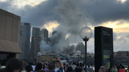 Smoke is seen rising from the Sydney CBD during a fire in the pool area of the Four Seasons Hotel. (Twitter)