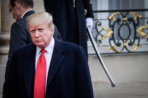 Donald Trump tweeted about the California wildfires while attending centenary commemorations marking the end of World War One.