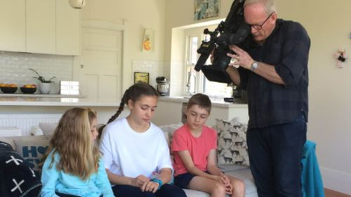 The 9NEWS camera captured siblings Lara, Sylvie and Carter with the Spacetalk safety smartwatch.