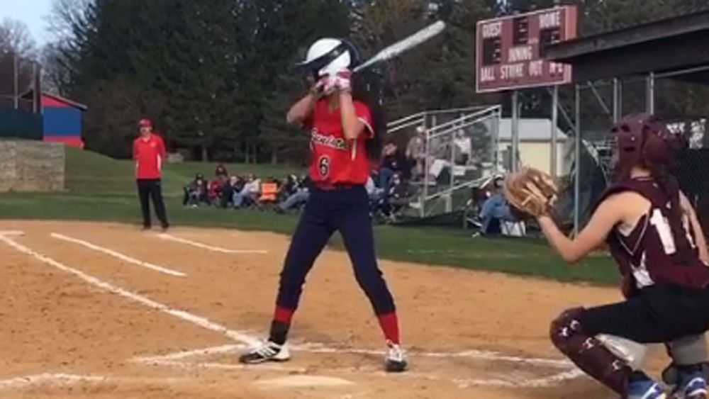 Softball player unveils stunning new trick shot