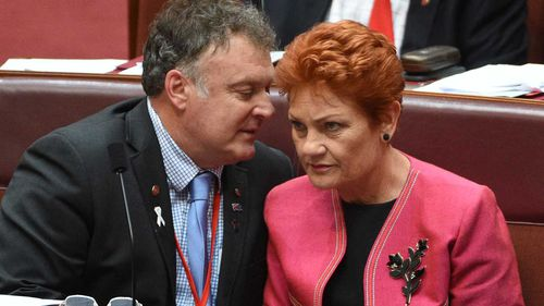 Rod Culleton speaks to Pauline Hanson in parliament last month. (AAP)