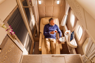 In first class suites on Emirates' Boeing 777-300ERs, a body-cradling seat reclines into a bed, which is pictured at the top of this story.